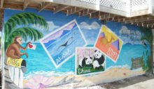 The colorful mural shows Holy Cross children to think outside of the box.