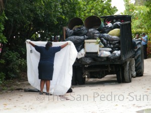 Police officials cover the body of Lazaro Pott at the scene of the accident.