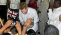 HRH Prince Henry of Wales greets children at the Diamond Jubilee Block Party (Photo 9 of 15 photo(s)).