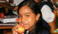 Apples and other treats are given out to the students at each school (Photo 6 of 10 photo(s)).