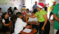 San Pedro Town Council brings Christmas treats to Primary School students (4) (Photo 5 of 10 photo(s)).