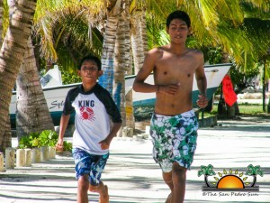 Eric runs alongside his little brother, who he encourages to join in sporting activities.