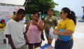 Belize Down Syndrome Association shares  information with attendees at Caye Caulker Health Fair (Photo 10 of 10 photo(s)).
