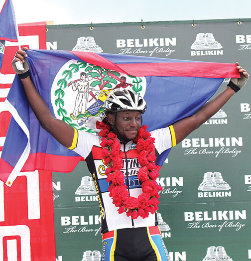 A victorious Darnell Barrow raises his Belize flag after taking the win and keeping the garland home for the second year in a row.  (Last year Giovanni Choto took the championship)