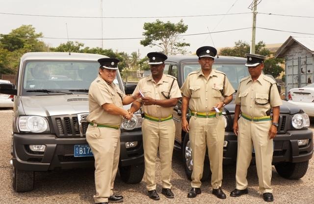 Deputy Compol Aragon hands over vehicles to OC  Northern Zone Joseph Myvette - accompanied by OC Orange Walk Dennis Arnold and- (1)