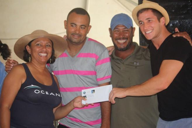 Oceana VP Audrey Matura Shepherd delivers 1st Prize to Winners Turtle Inn