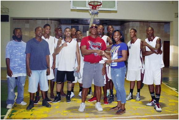 Allison'Harrier' Laing presenting $1000 cash prize to president of the Dangriga Basketball Association Mrs. Sharon Williams