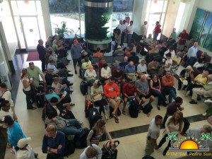 Delayed passengers crowd Tropic Air departure lounge in San Pedro Town.