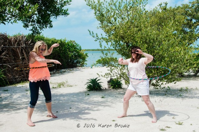 Girls Hula hooping  at the Red Cross fundraiser at Stella's Smile by Karen Brodie Photography
