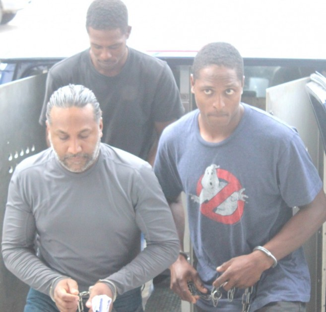William Mason being escorted to the Belize Magistrate Court