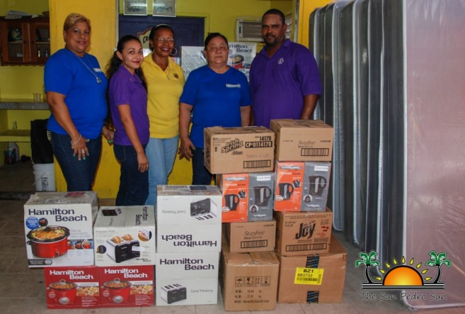 Courts Belize Donates Fire Relief-1