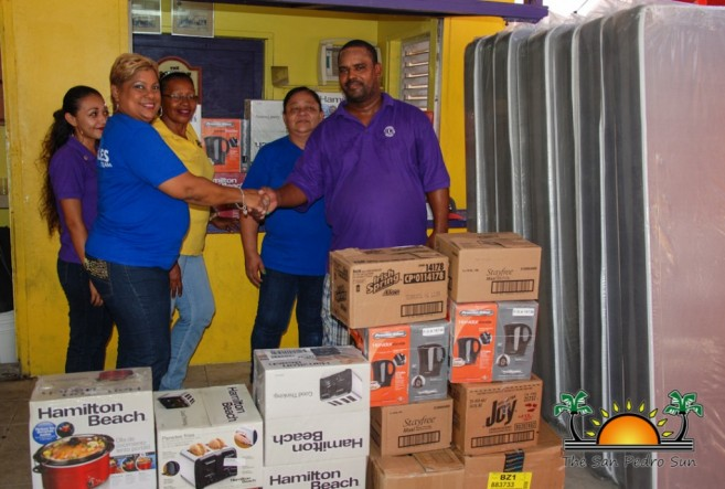 Courts Belize Donates Fire Relief-2