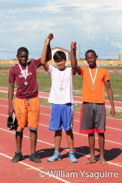 Melvin Rauldares ( center) won Gold in long Jump at 4.90 metres.